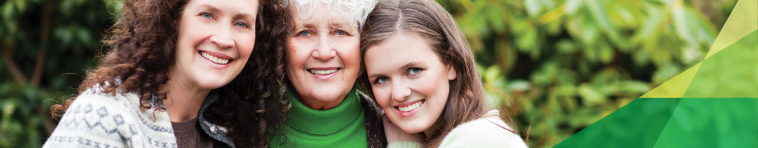OB/GYN Services: three women, a young, middle aged and older woman are smiling and embracing each other